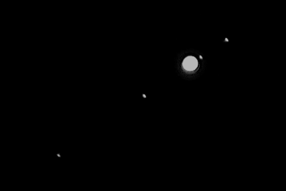The four Galilean moons of Jupiter as they may appear in good binoculars