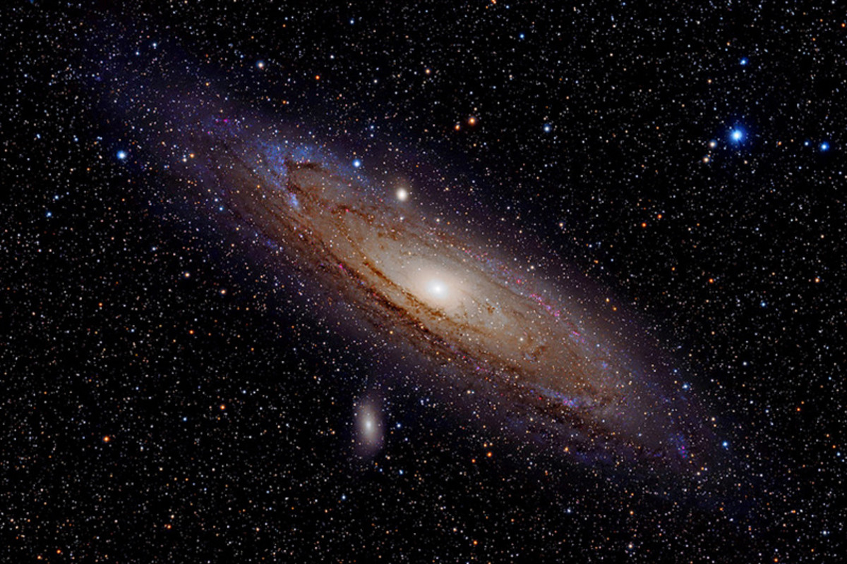The Andromeda Galaxy. Sadly the galaxy will not look anything like this in binoculars! But this is what you are looking at when you see that fuzzy patch. Just left of centre are two attendant dwarf galaxies: M32 (above) and M110 (below).