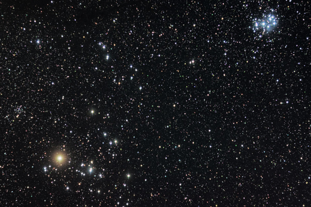 The Hyades and Pleiades in the constellation Taurus. The bright orange star is Aldebaran. Immediately right of Aldebaran is the cluster of stars which make up the Hyades. In the top right is the more conspicuous Pleiades