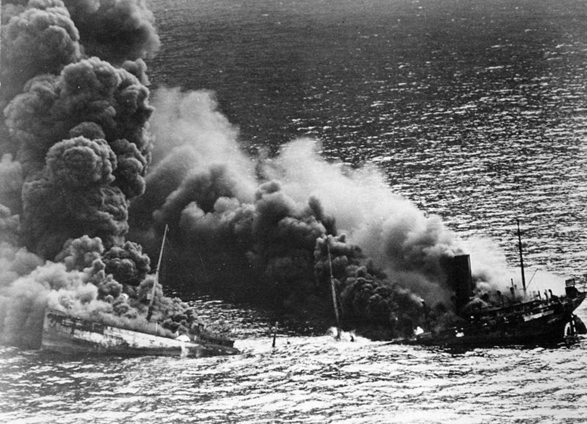 WW2: Allied tanker torpedoed in Atlantic Ocean by German submarine. Ship crumbling amidship under heat of fire, settles toward bottom of ocean. March 26, 1942.