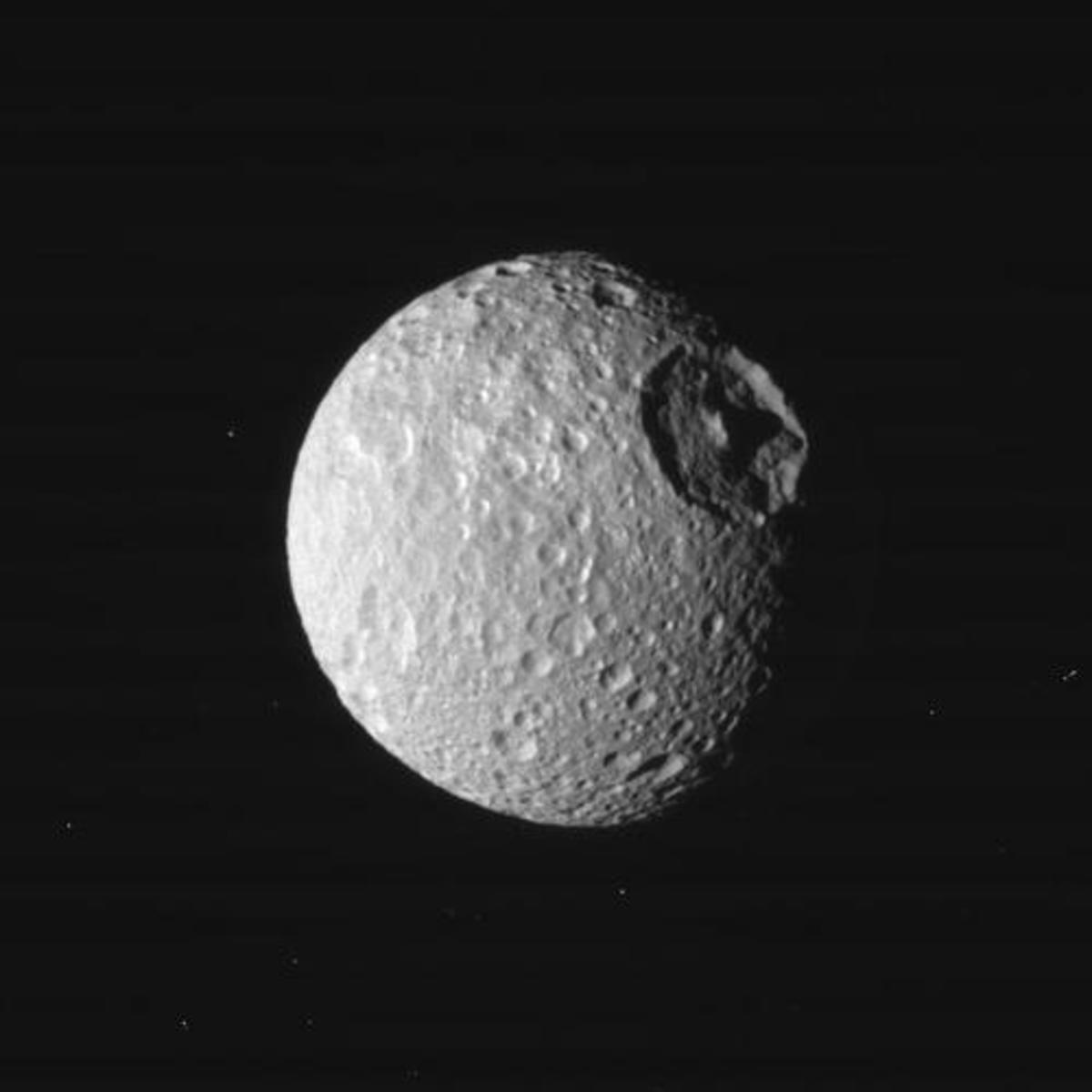 """That's no moon, it's a... oh, nevermind, it IS a moon."" NASA scientists tend to refer to Mimas as the ""Death Star moon"" thanks to the 80-mile-wide impact crater that just barely failed to shatter it. (The moon Mimas is about 245 miles in diameter.)"
