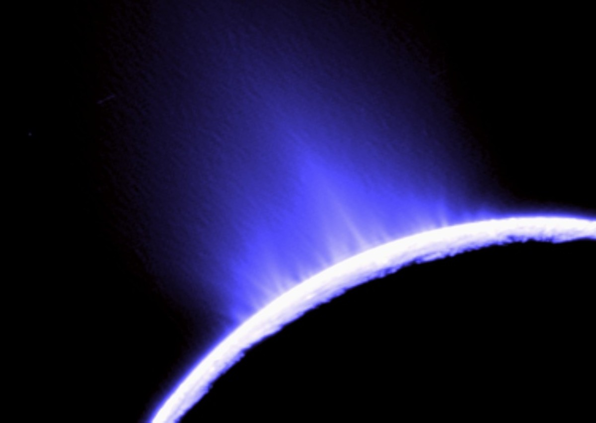 Backlit ice geysers spew from Enceladus' southern limb, shooting plumes of frozen water hundreds of kilometers into space.