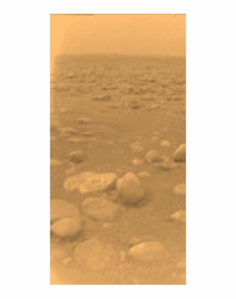 "It doesn't look like much, but this photo from the surface of Titan is our first landing on a world beyond Mars -- 887 million miles from the Sun. A smoggy methane haze dominates. Pebbles are actually water ice, the ""rock"" on Titan."