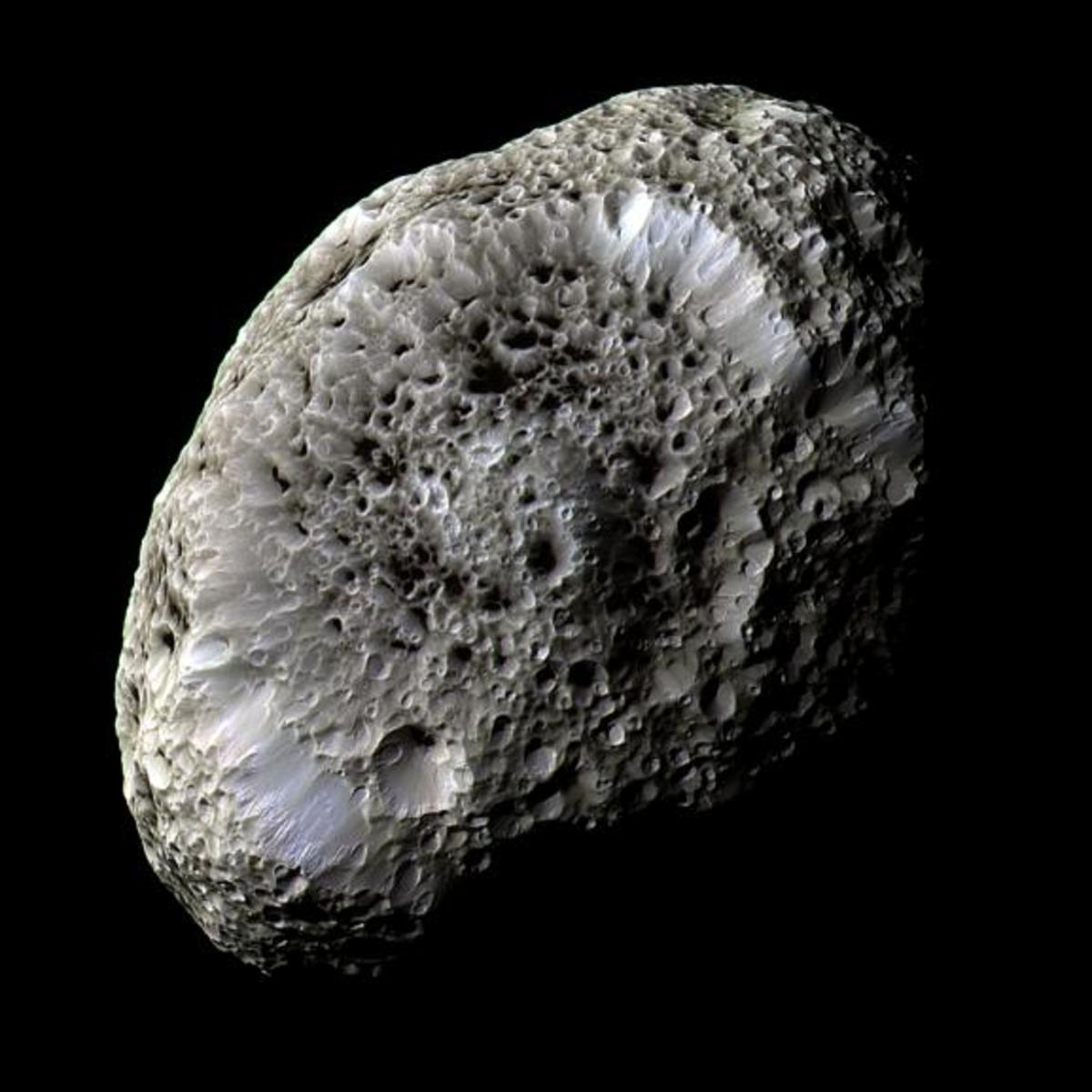 The moon Hyperion. Smaller bodies (it's 255 x 163 miles) don't have enough gravity to pull them into a spheroid shape; they tumble like space potatoes. Hyperion seems to be a loosely-packed sponge or honeycomb of dirty ice.