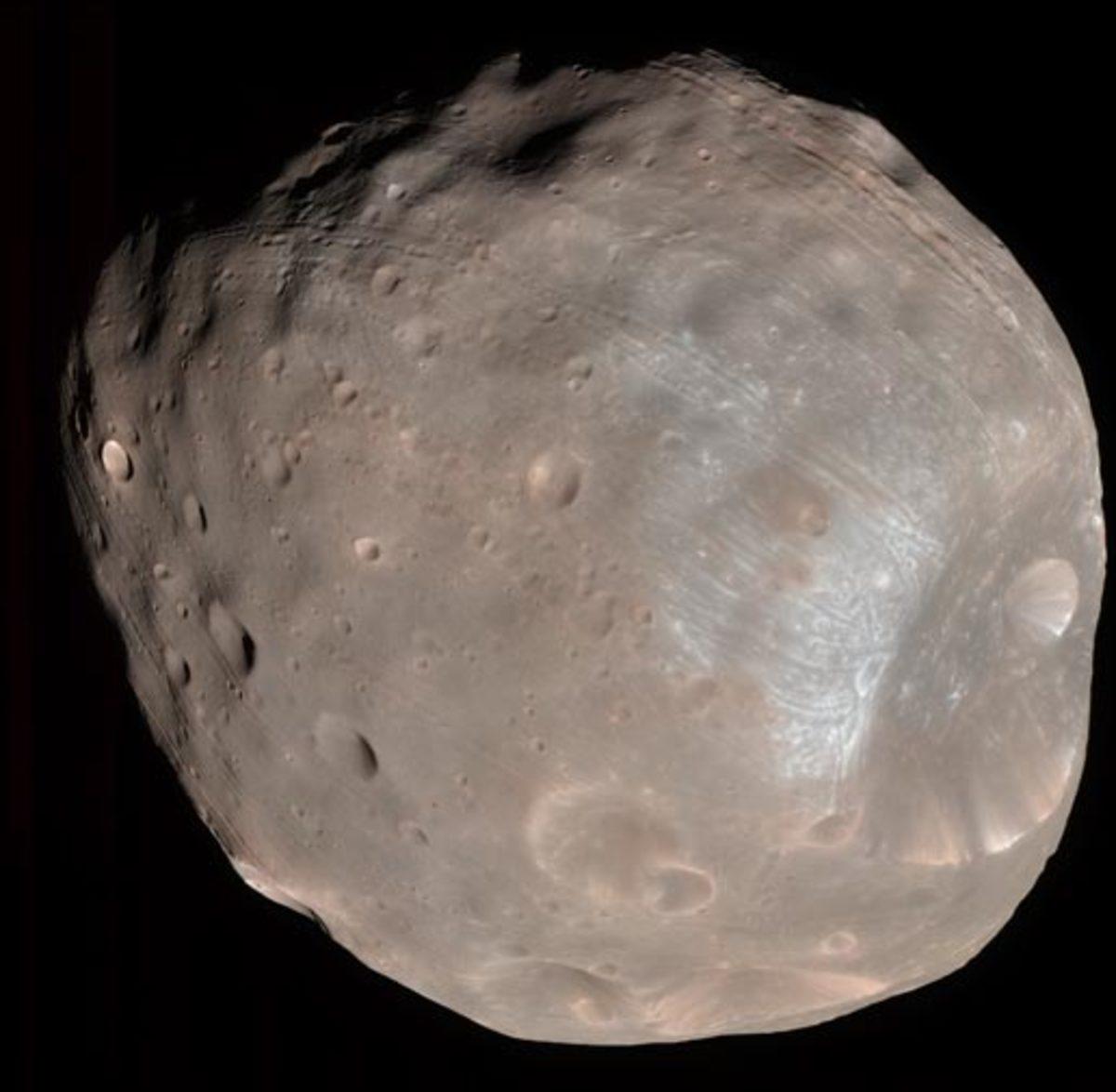 About 17 miles long, Phobos appears to be a captured asteroid circling Mars. In fact, it's caught in a death spiral: if Mars' gravity doesn't tear it apart into a ring, it will crash into the suface in ten million years.