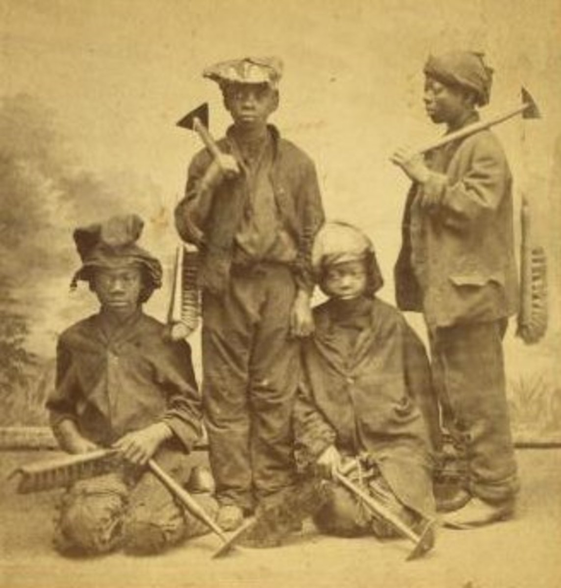 Studio picture of African American child apprentice chimney sweeps by Havens O. Pierre. Taken sometime between 1868 and 1900.