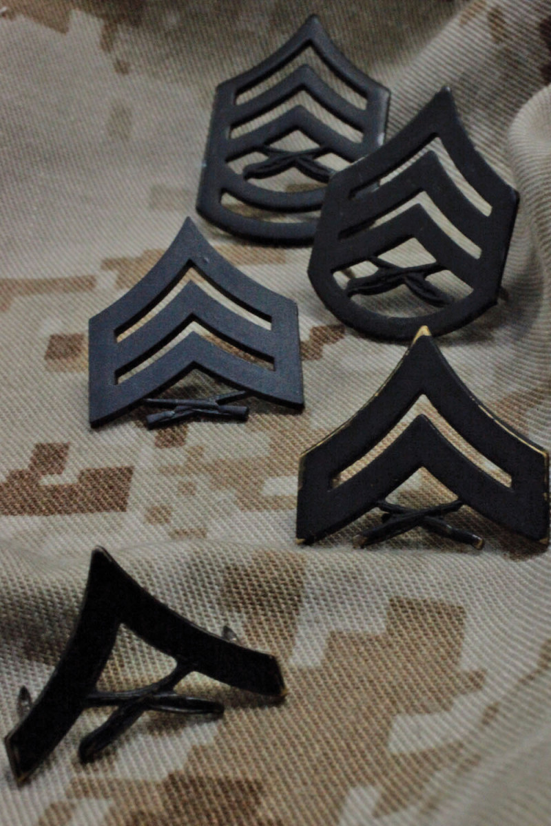 Officers and Enlisted Marines have many differences between their uniform details to distinguish their roles and history.