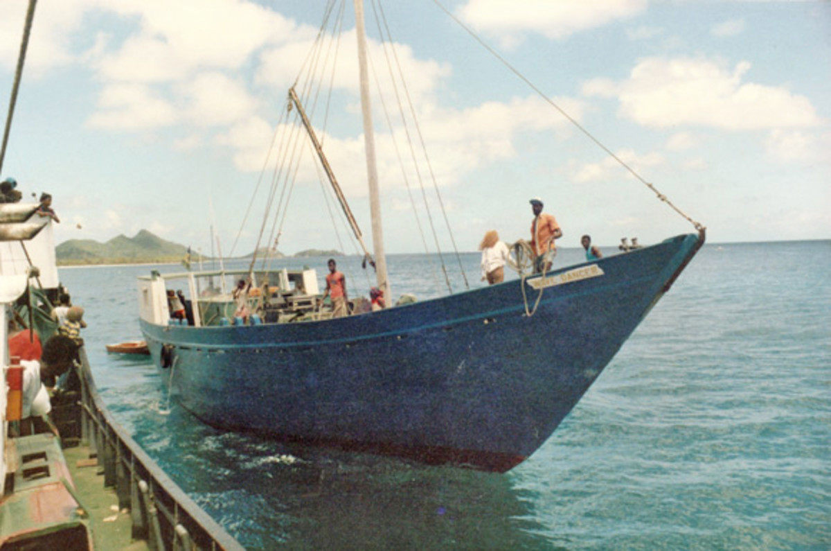 Water transports boats of all sizes filled with people, mail, and physical goods. Taken in the West Indies, 1985.
