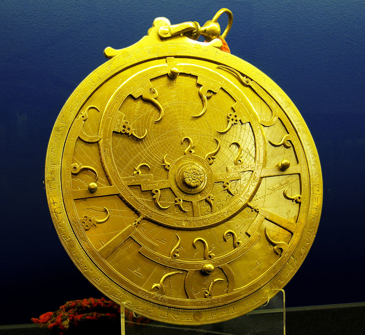 An 18th Century Persian astrolabe – maker unknown. The points of the curved spikes on the front rete plate, mark the positions of the brightest stars. The name of each star being labeled at the base of each spike. The back plate, or mater is engrav