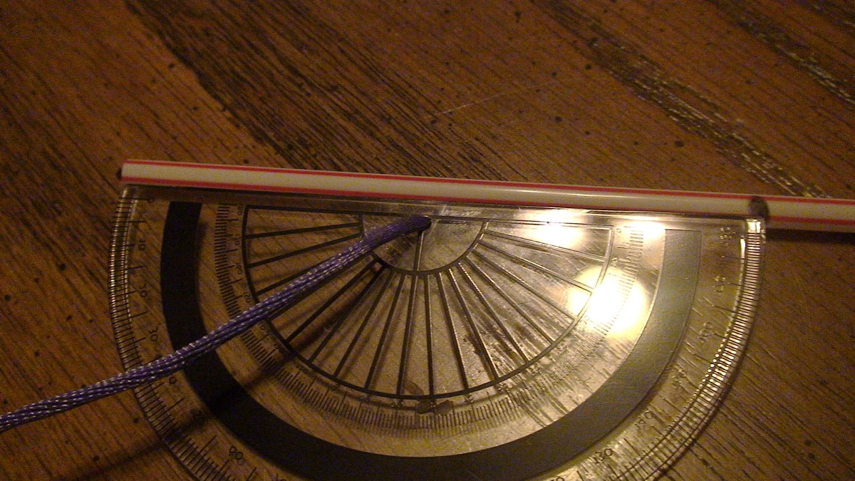 Measure the straw to be used as the sight vane.