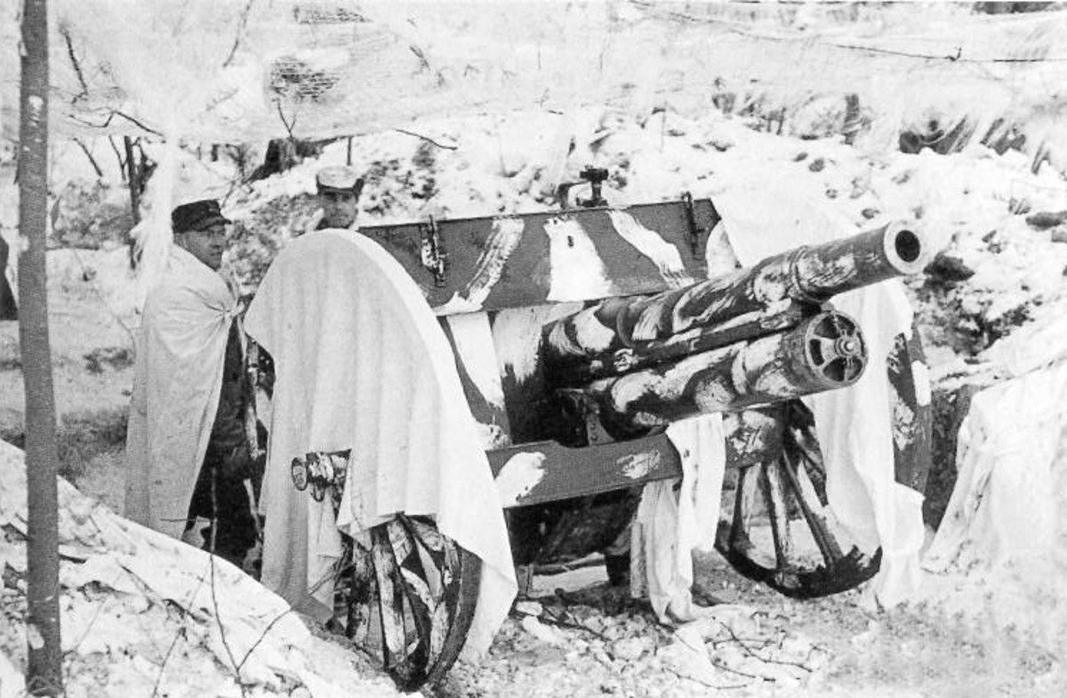 WW2: The most common Finnish artillery was a 76 millimeter gun dating back to around the year 1902. The gun stands as camouflaged in the city of Viipuri in March 1940