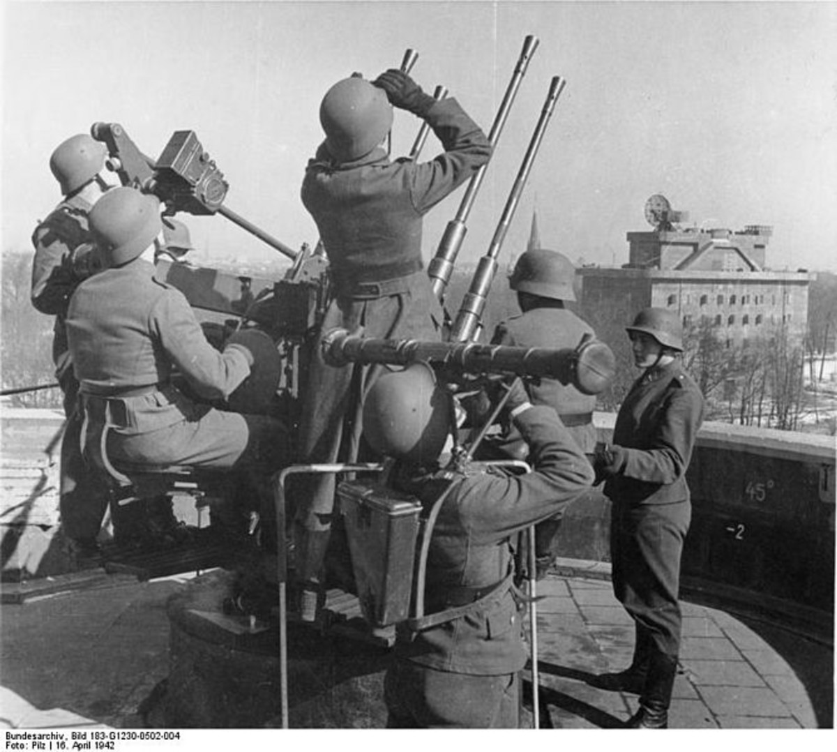 WWII: Berlin: 20 mm anti-aircraft crew on a G-Tower (Combat Tower). In the distance is its sister L-Tower (Command Tower).
