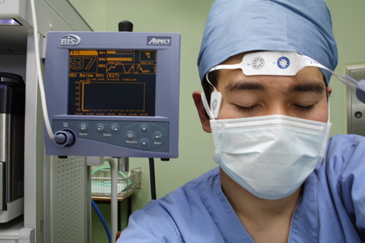 "Demonstration of a BIS monitor. This ""patient"" is fully conscious as demonstrated by the number ""97"" on the monitor behind him."