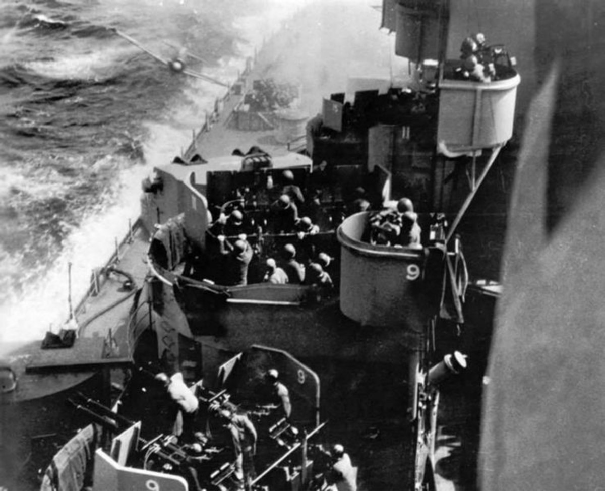 "WWII: Kamikaze attack on the USS Missouri (BB-63). About to be hit by a Japanese A6M ""Zero"" Kamikaze"