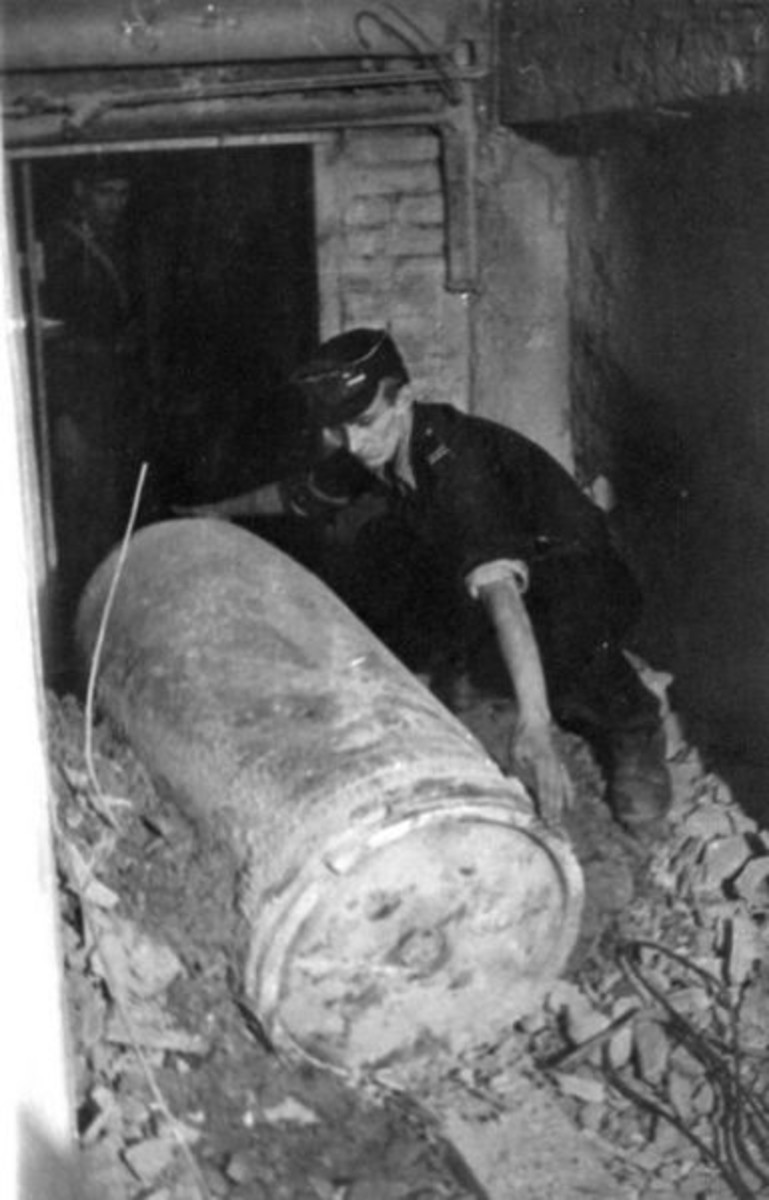 "WWII: Warsaw Uprising: Polish Home Army soldier measuring length of 600 mm dud ammunition from a ""Karl"" mortar."