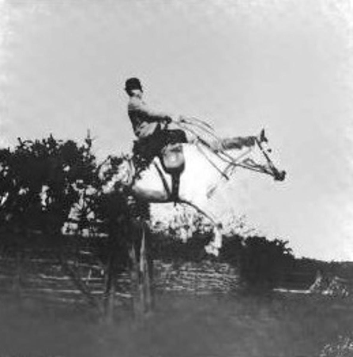 Man riding sidesaddle (1903) -- public domain image