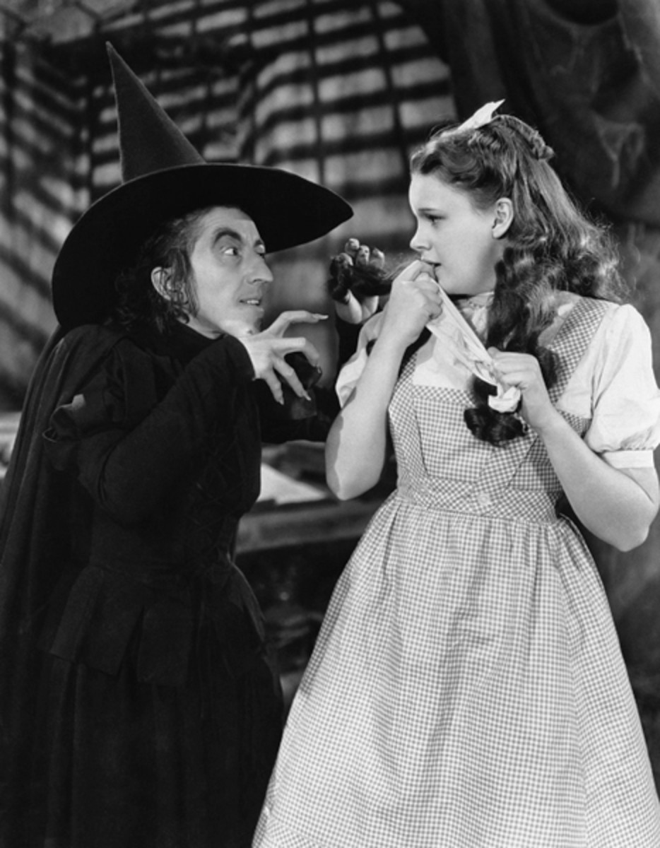 Margaret Hamilton as the Wicked Witch of the West and Judy Garland as Dorothy in The Wizard of Oz.