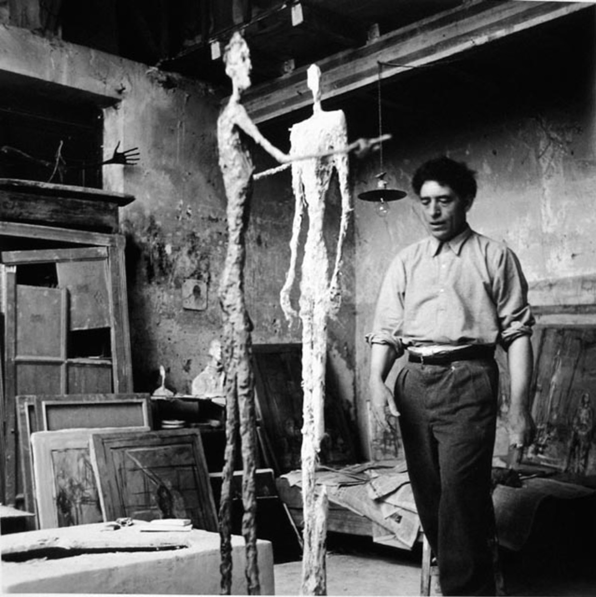 Giacometti and thin lady in studio.