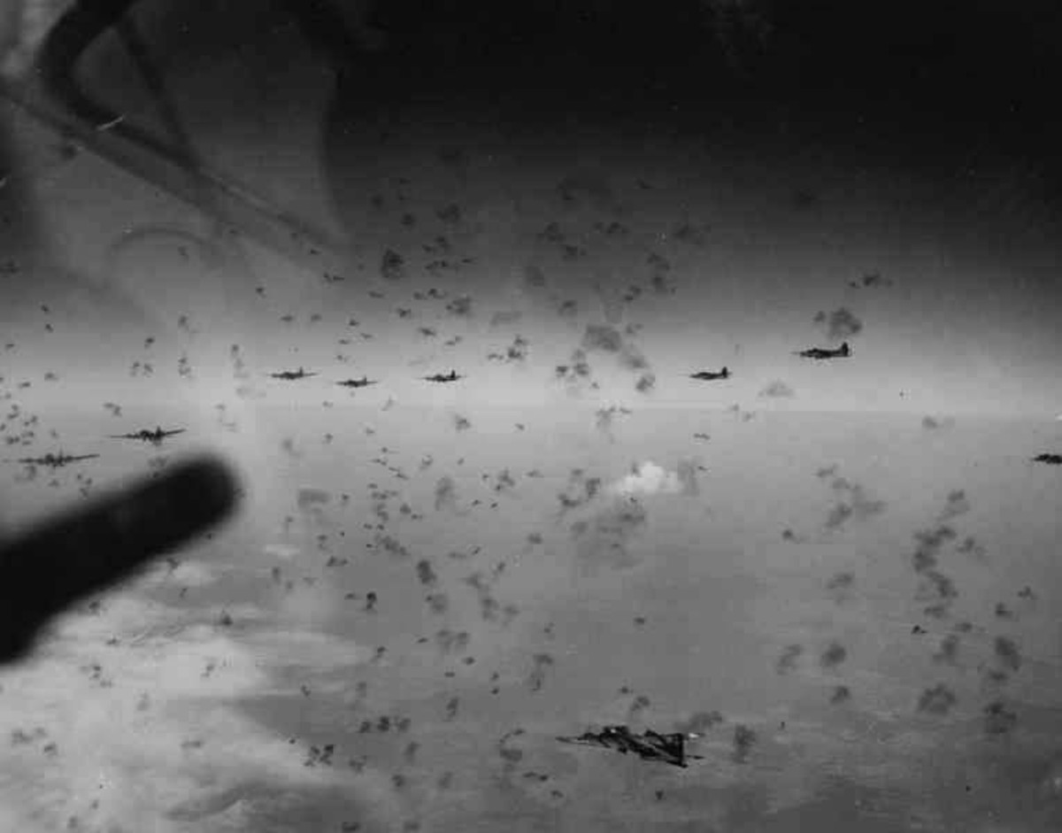 WW2: B-17 Flying Fortress bombers flying through dense flak.