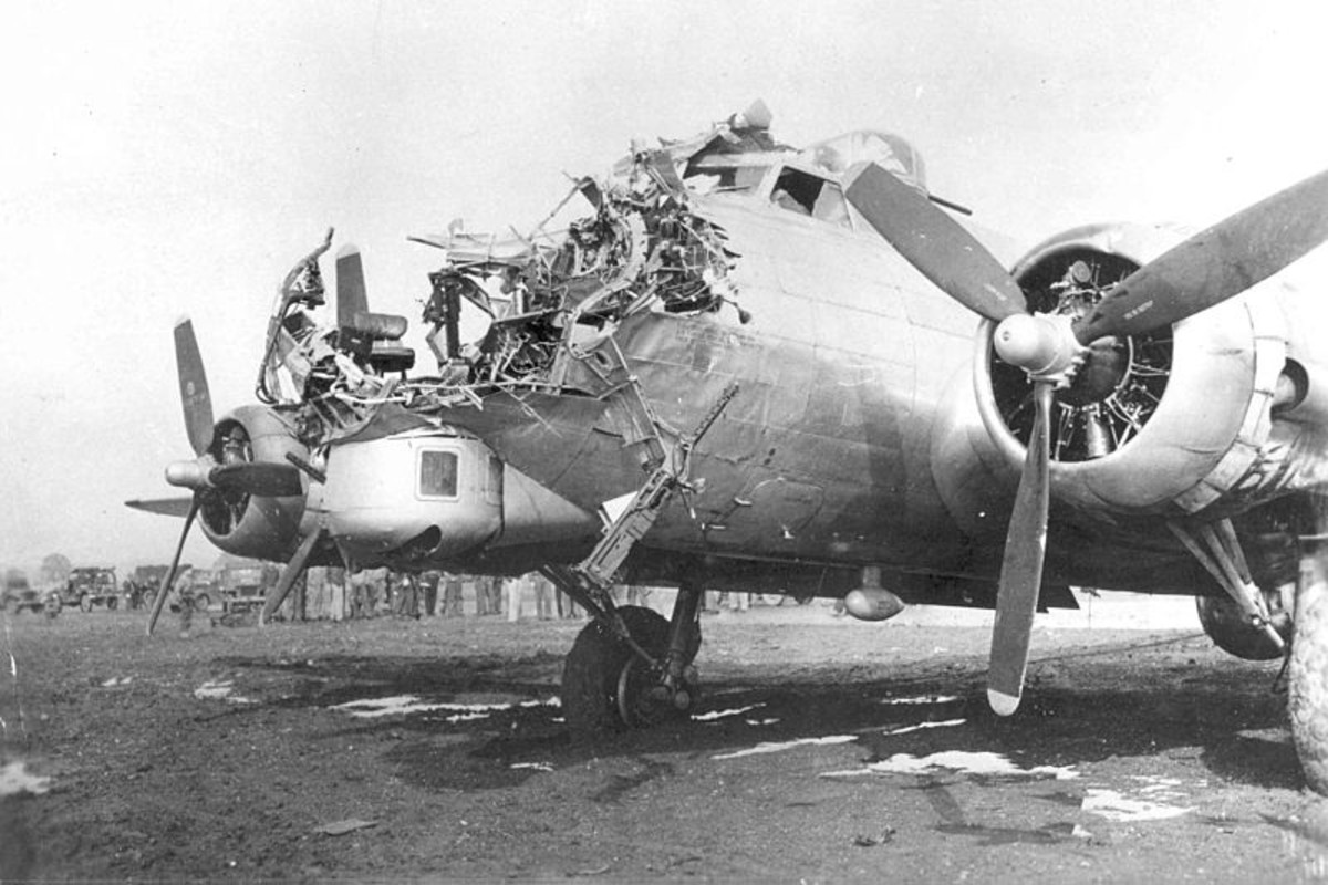 WWII: B-17 with severe nose damage incurred during a bombing mission. Flying Fortresses could take a lot of punishment and remain in the air.
