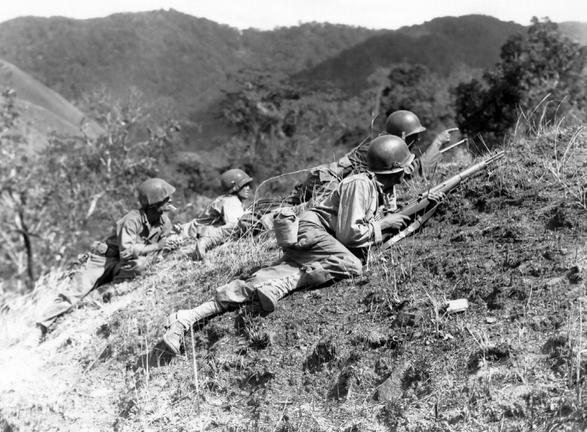 The infantry advances under air cover provided by the Aztec Eagles. Baleta Pass, near Luzon