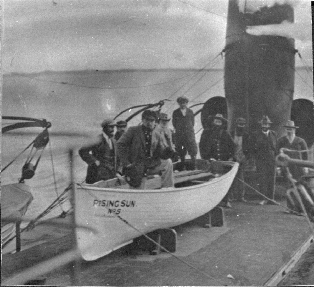 The crew aboard the Rising Sun.