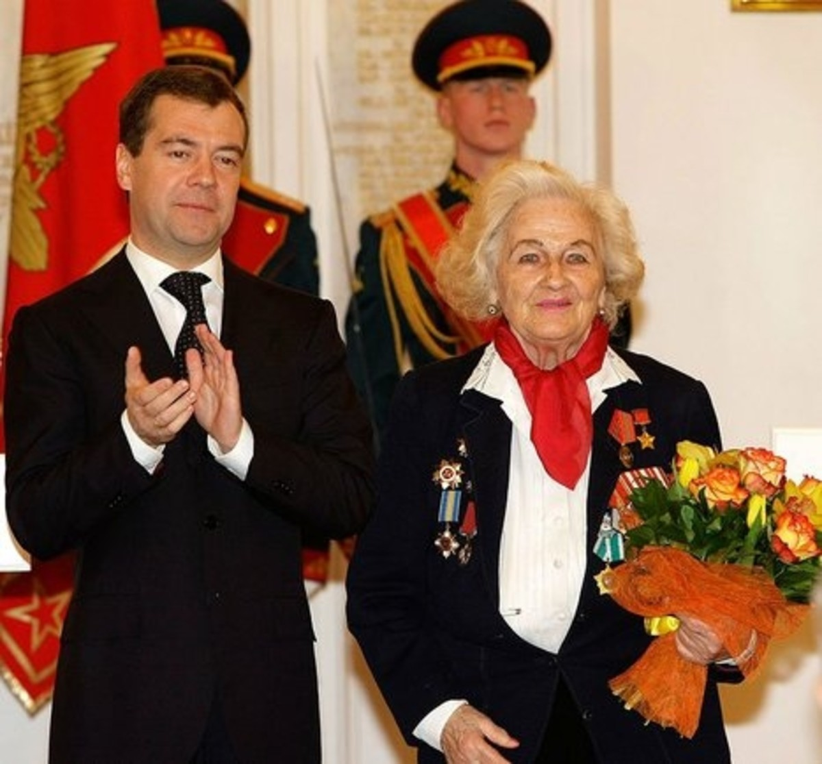 WW2: Nadezhda Popova. As a Night Witch she was shot down several times. She flew 18 missions in one night. Standing with Russian president Medvedev in 2009