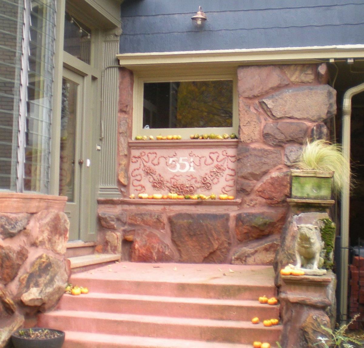 Closeup view of entrance at 551 W. Stratford Place.  Note detailed ornamentation on address stone.