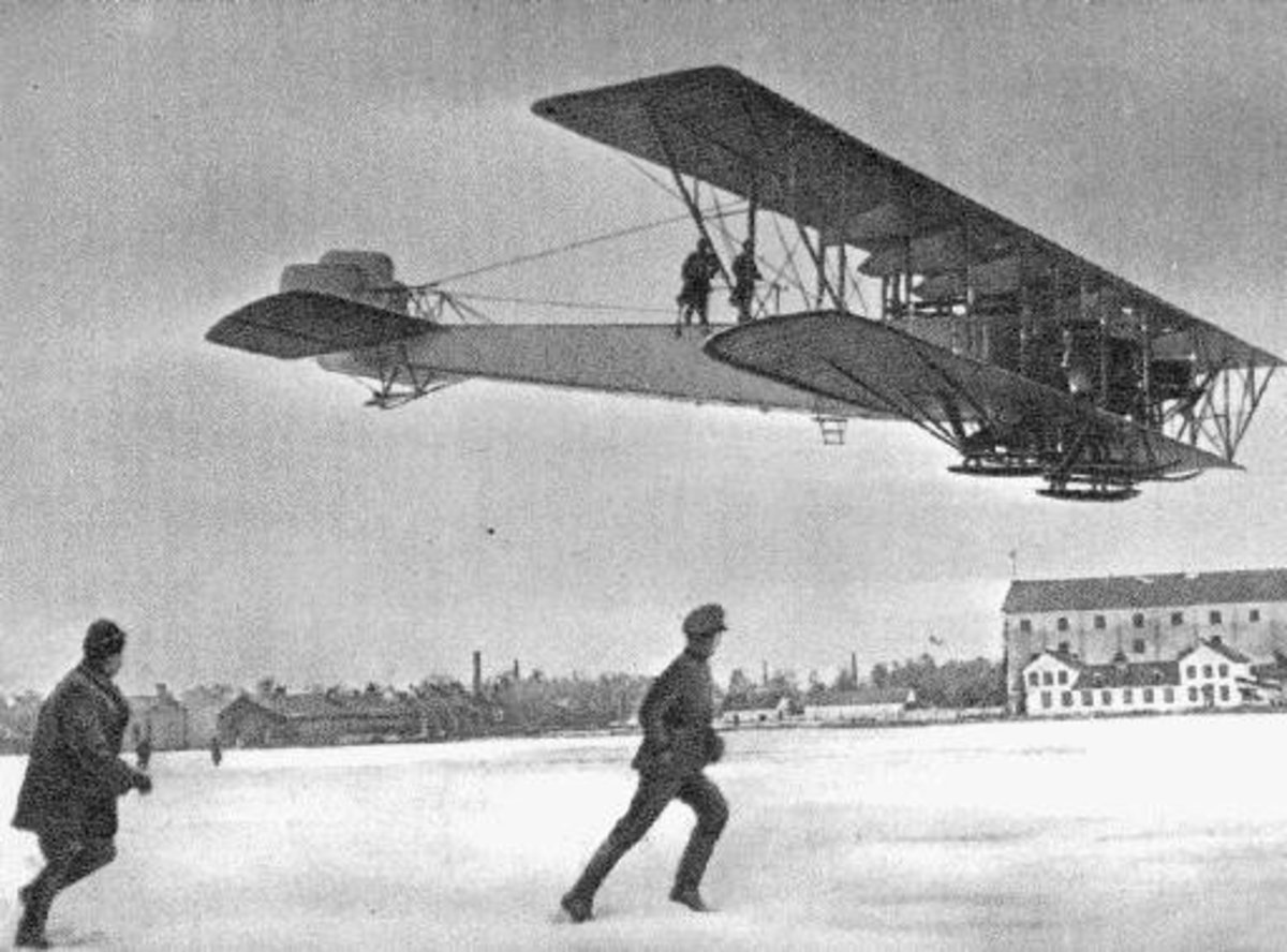WWI: Four-engine Russian Ilya Muromets heavy bomber. Note the two men standing on the fuselage and the winter skis.