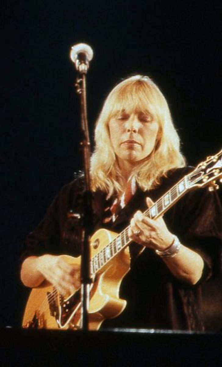 Joni Mitchell performing in 1983 at age 40
