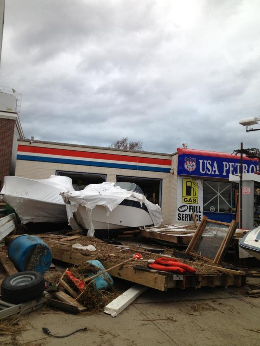 Boats are thrown into a gas station, Island Park, NY