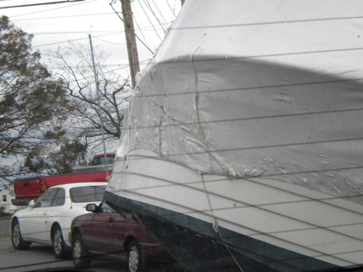A boat sits atop a car in Baldwin, NY