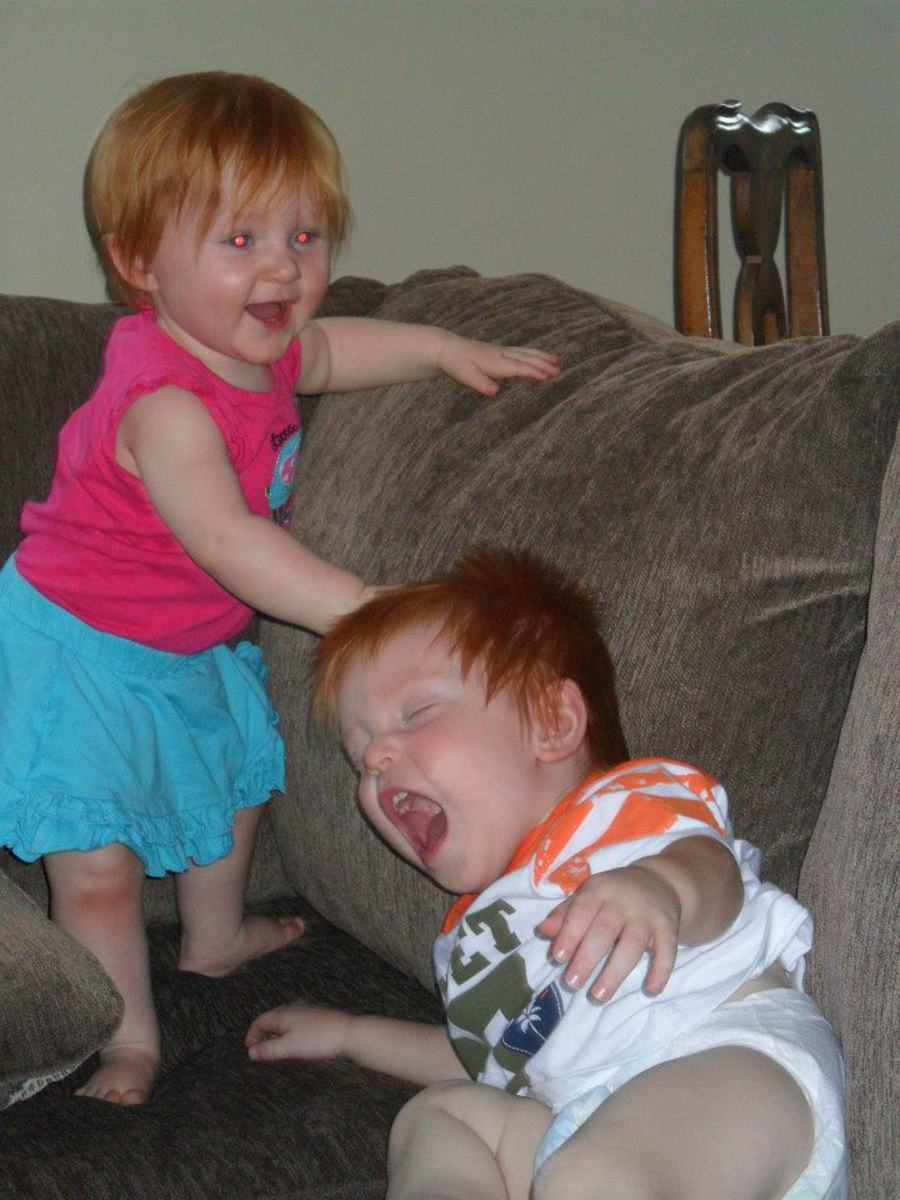 This is my niece and my cousins son.  My niece is not violent but this was a funny picture that I thought embraced the concept.