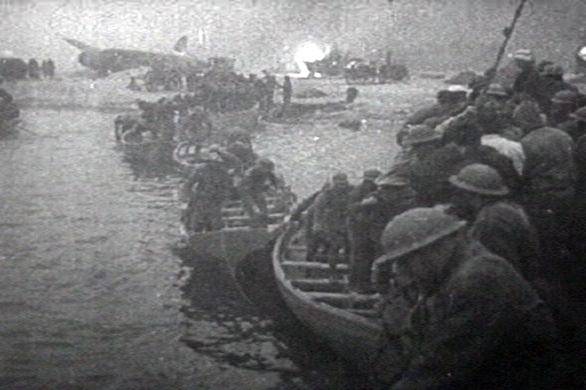 British troops in lifeboats en route to a ship, while under fire from the Luftwaffe.