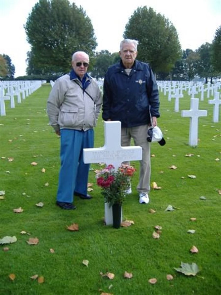 John Gatens (A btry) and John Schaffner (B btry) of the 589th Field Artillery visit the grave of Lt. Francis O'Toole (A btry).  Both men were at Parker's Crossroads. Mr. Gatens was captured. Mr. Schaffner made a harrowing escape into the forest.