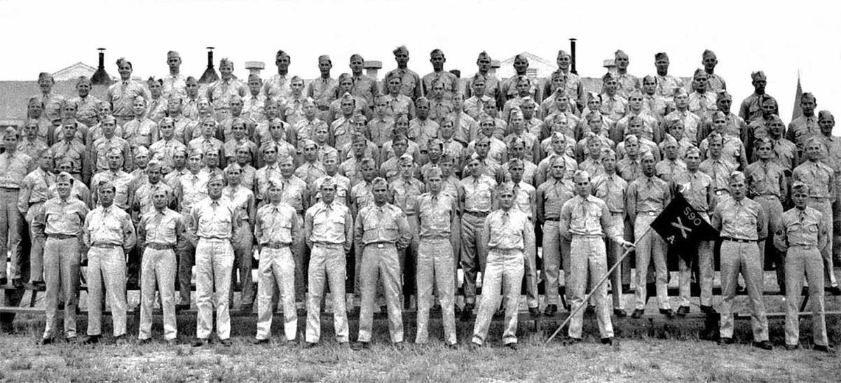A Battery, 590th Field Artillery. The entire battery was either captured or killed. The CO, Captain Pitts (front row, center) was killed on Dec. 16.  Another officer, Lt. John Losh (next to flagbearer) was killed in captivity.
