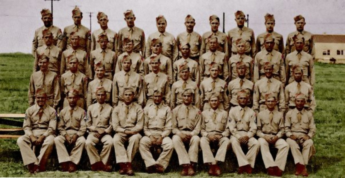 Battery A, 589th Field Artillery, Summer 1944. John Gatens is in the 2nd row, fifth from the right.