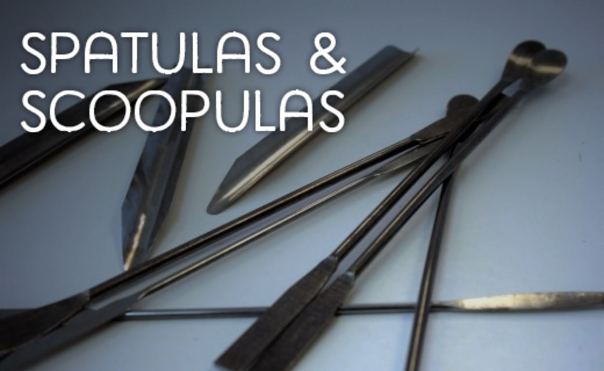 Three scoopulas on the left and a number of spatulas to the right.