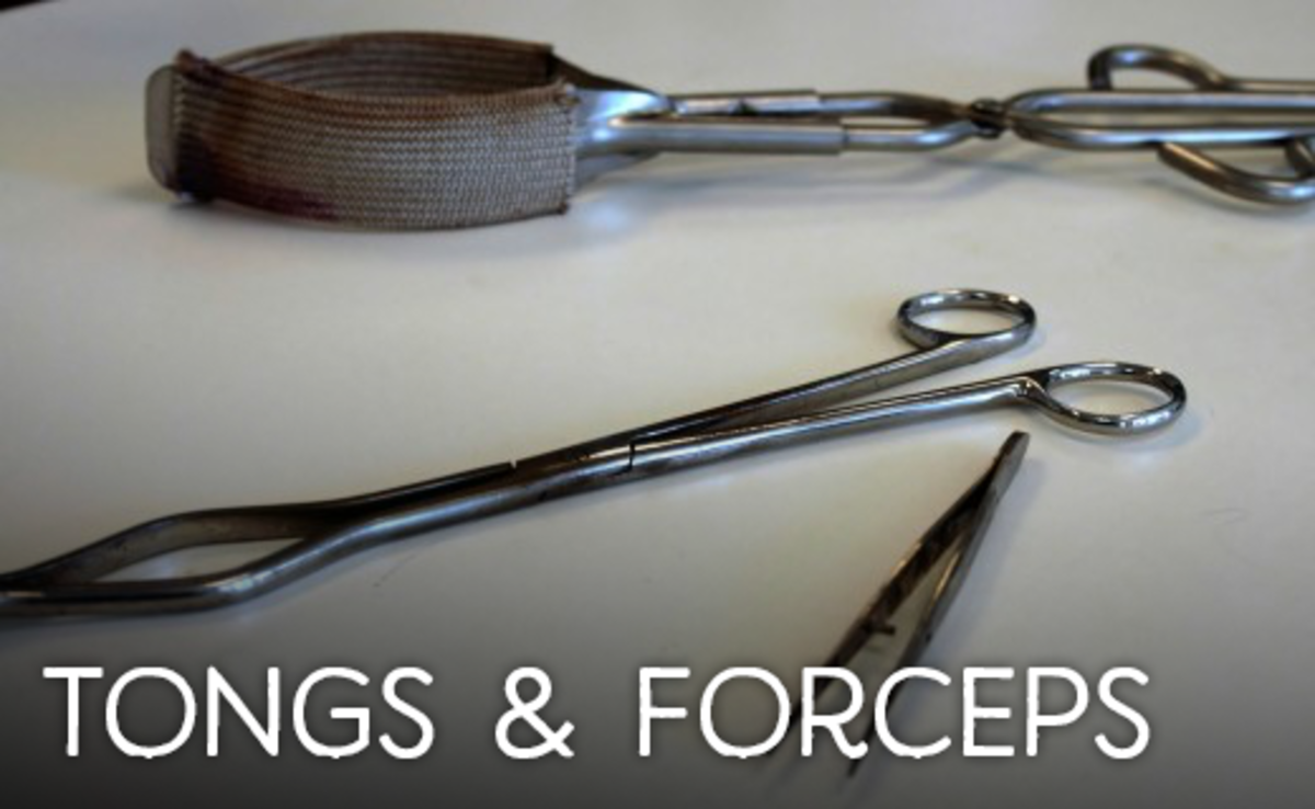 Two tongs above and a pair of forceps below