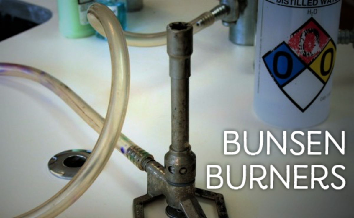 An unlit bunsen burner connected to a gas source