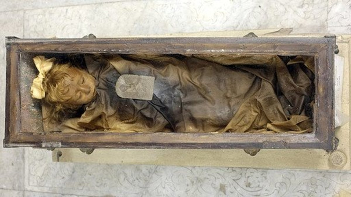 Rosalia inside her tiny glass coffin. Nobody has opened it since she was placed inside. Notice the lid shown in the photo above has been removed.