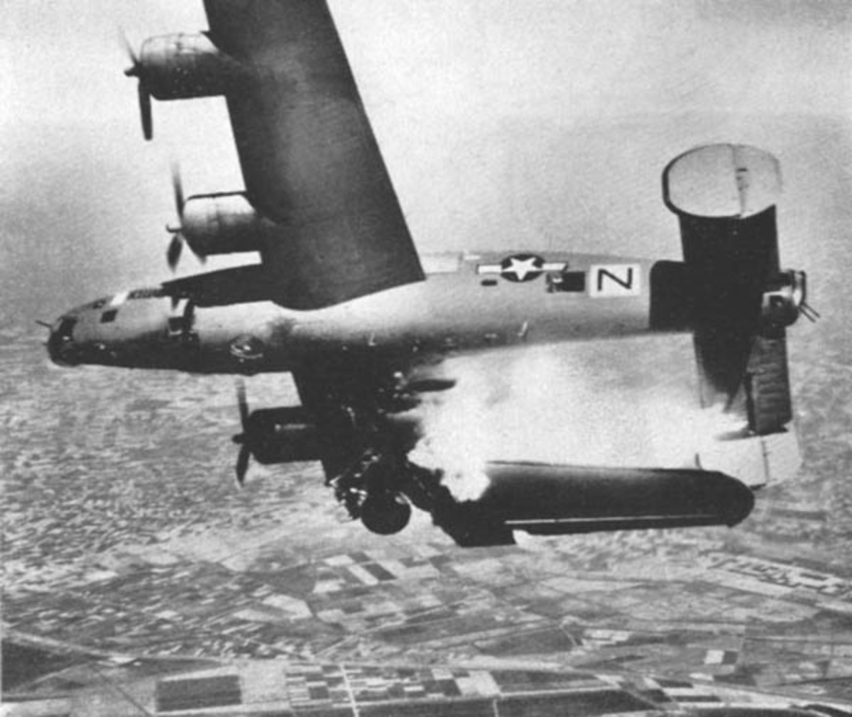 B-24 going down over Italy. Only 1 crewman survivied.