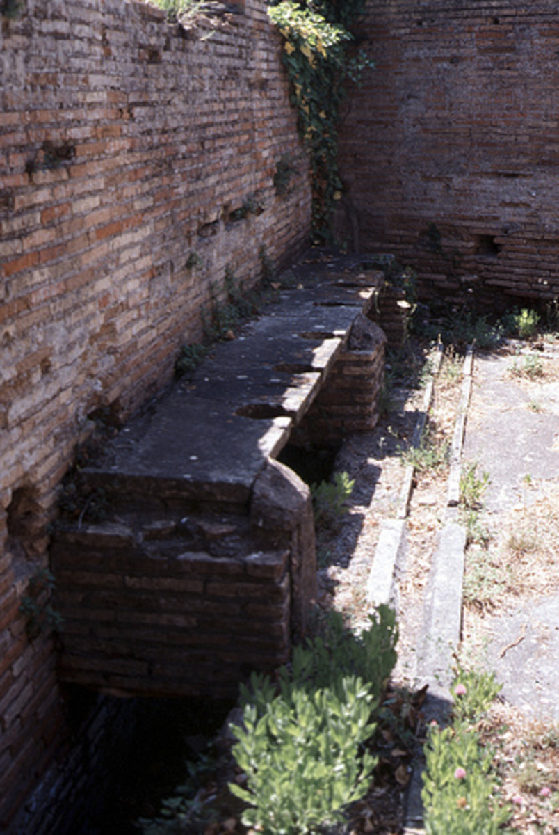 An Ancient Roman Latrine. Running water flushed the waste away but there was no paper. Sponges on sticks and soaked in salty water were used instead.
