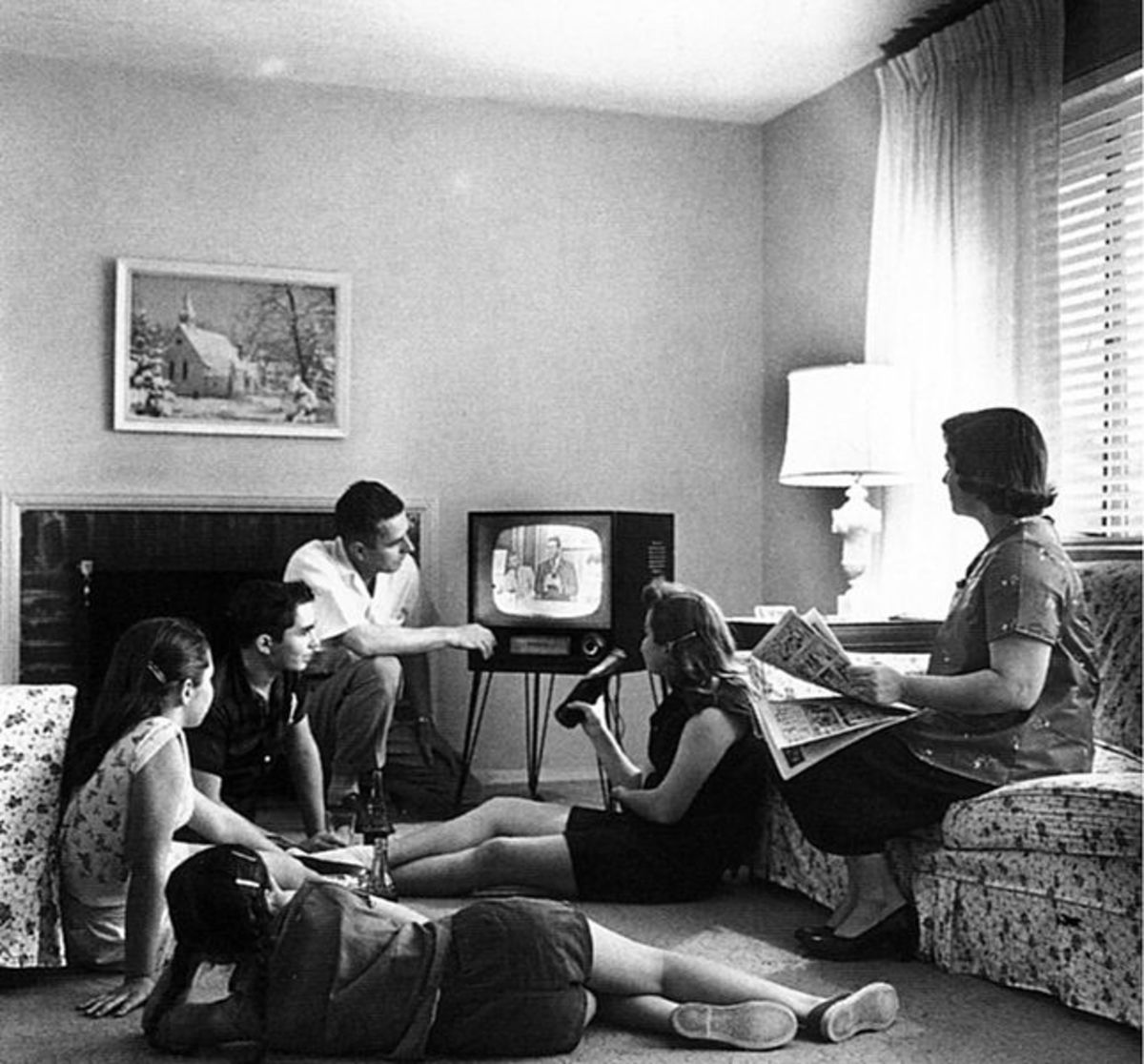 A family watching television together in 1958.
