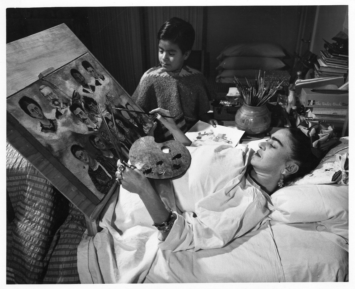 Frida Kahlo painting while confined to her bed.