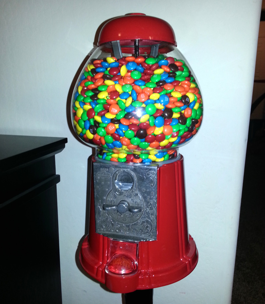 I recently purchased this King Gumball Machine for my kids. It holds about 5lbs of M&Ms (about 2,350 of them).