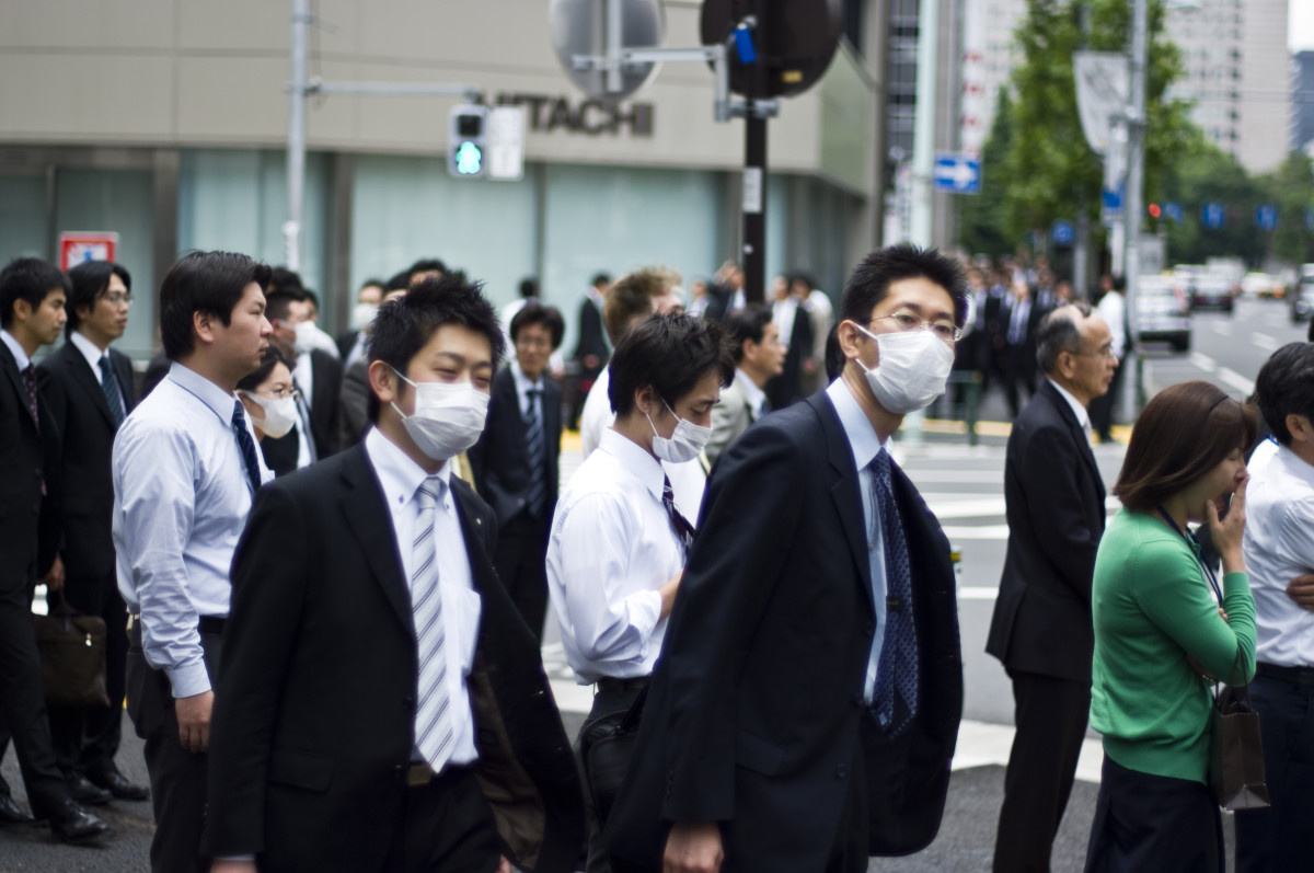 People wearing masks.  Fear of SARS or Swine flue causes many people to wear face masks.
