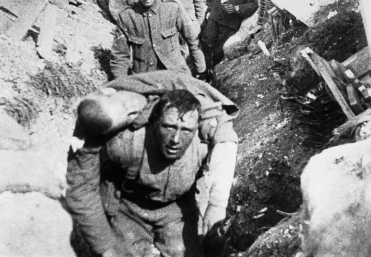 A wounded soldier being helped to safety.