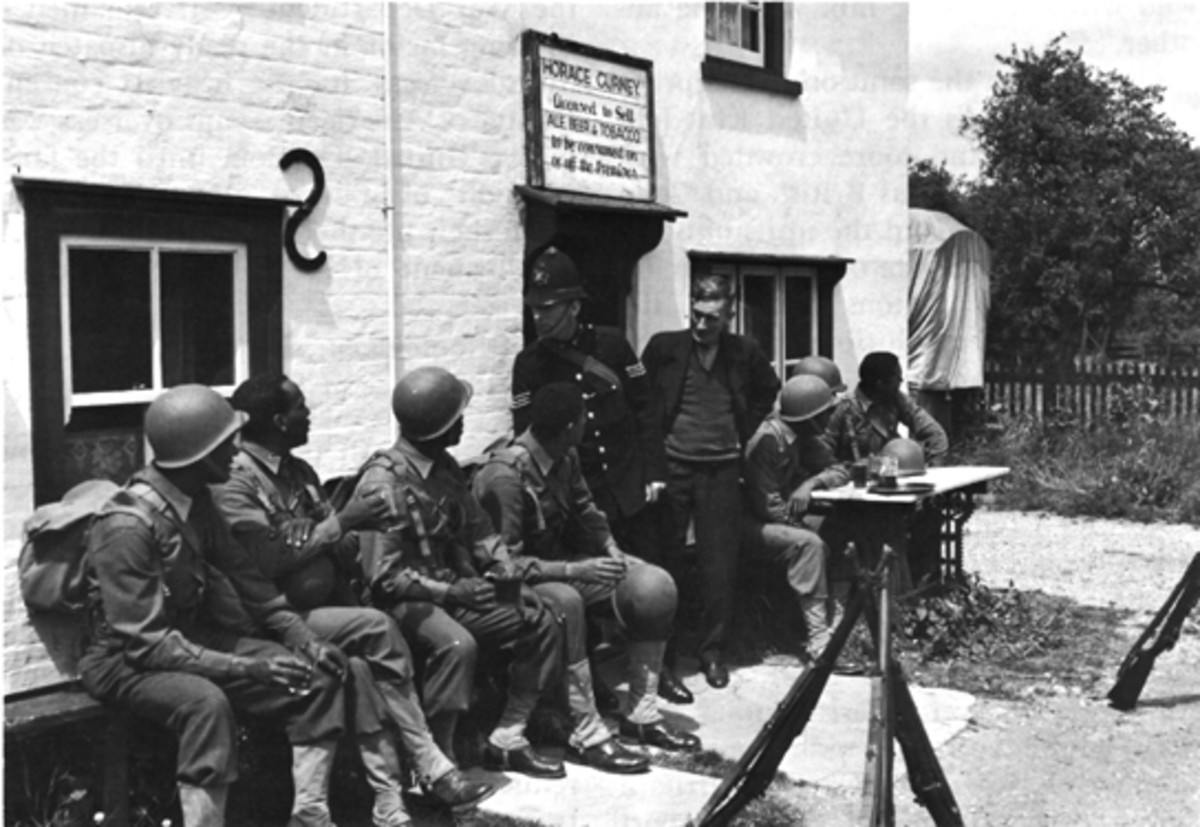 Black troops enjoying hospitality in the UK. Relations were good between the British public and Black Americans.