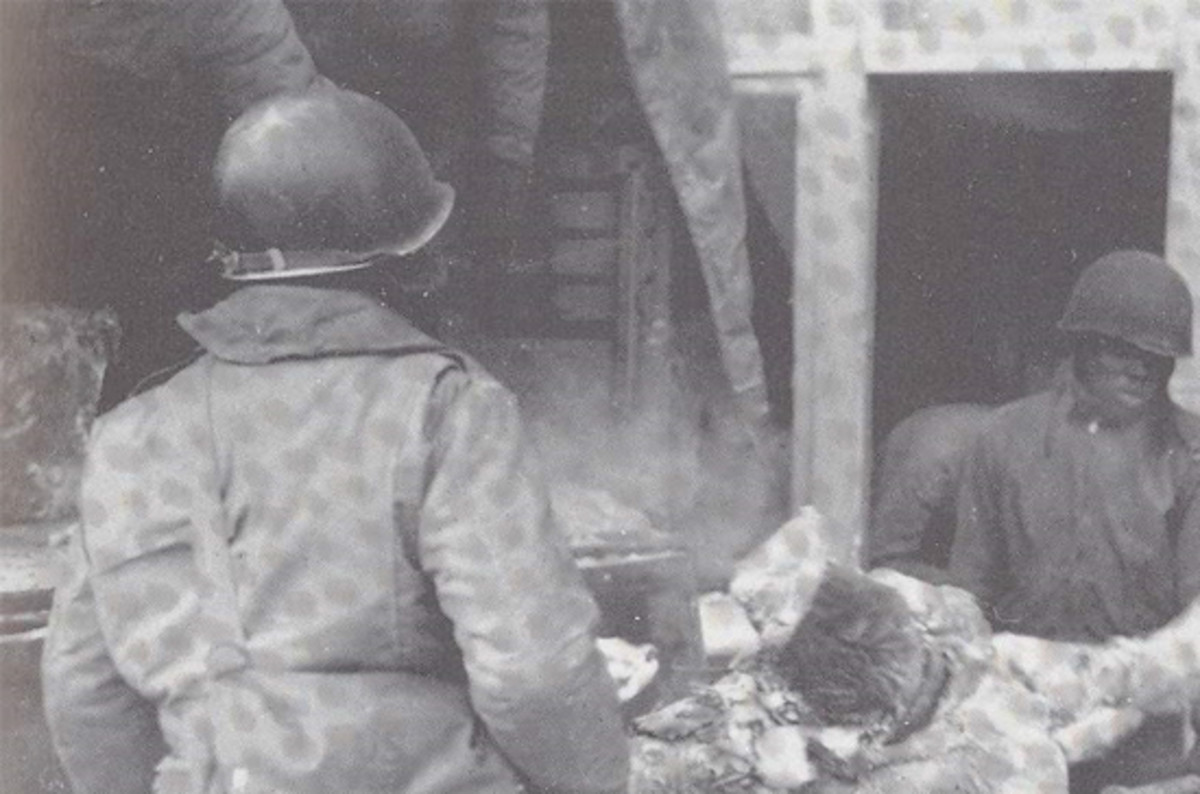 Members of the 3200 Graves Registration Unit loading bodies from the Malmedy Massacre.